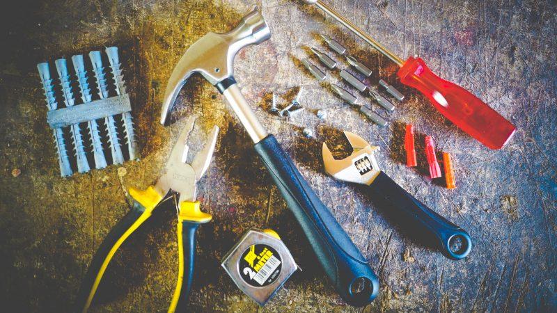Hammer Wrench Tweezers and Screw Driver on Floor