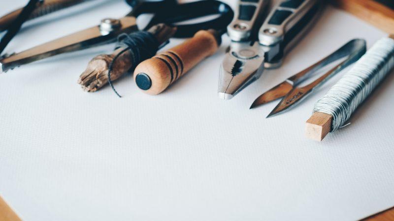 Wrench Tweezers Scissors String on Desk