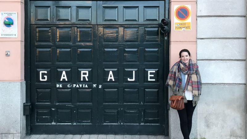 Justine Image of Woman Standing Next Too GARAJE Doors