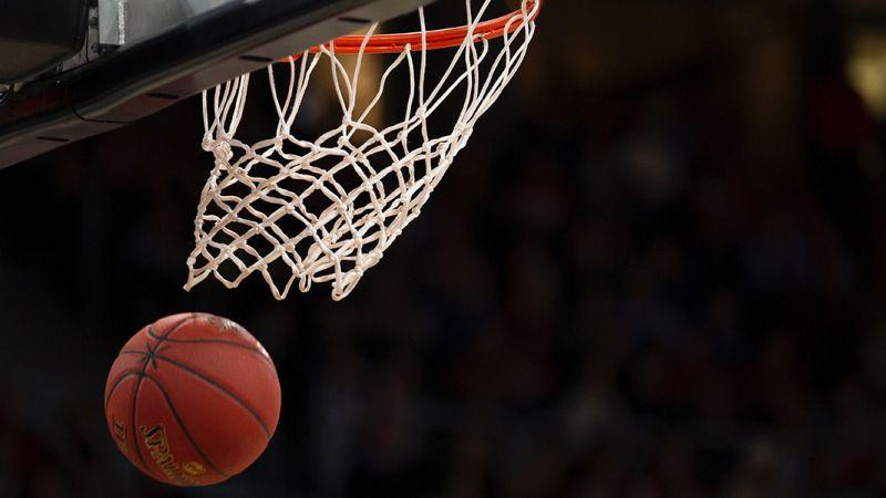 Basket Ball Going Through White Net
